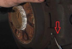 remove_brake_caliper_spring